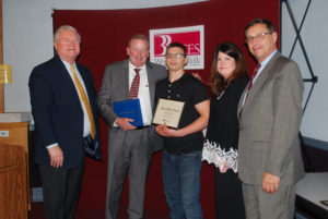 Alex Obert-Thorn (center) is congratulated by (from left) BOCES COO Michael Flynn, Principal Daniel Loughran, Executive Director Nancy Kelsey and Board President Peter Wunsch.