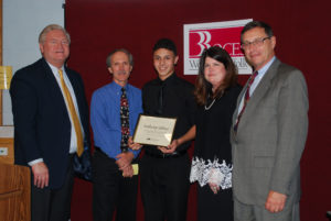 Anthony Sabino (center) is congratulated by (from left) COO Michael Flynn, Digital Film and Video Production teacher Steve Stankowski, Executive Director Nancy Kelsey and Board President Peter Wunsch.