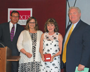 Carol Vogt, second from right, receives an Outstanding Achievement Award