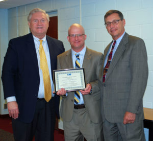 Dr. Timothy Eagen (center), Superintendent of the Kings Park School District, accepts a Proclamation of Appreciation from Western Suffolk BOCES Chief Operating Officer Michael Flynn (left) and Board of Education President Peter Wunsch for his district's support of the External Diploma Program.