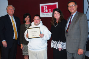 John Cronin (center) is congratulated by (from left)BOCES COO Michael Flynn, Counselor Karen Campagnini, Executive Director Nancy Kelsey and Board President Peter Wunsch.