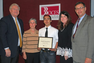 Joseph Pasqualone (center) is congratulated by (from left) COO Michael Flynn, HVAC teacher Elizabeth Cohen, Executive Director Nancy Kelsey and Board President Peter Wunsch.