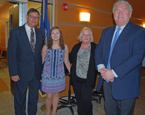 Scholarship winner Kathrine Zeffer is congratulated by BOCES Board President Peter Wunsch, Suffolk Region PTA Director Kathy Vento and BOCES COO Michael Flynn