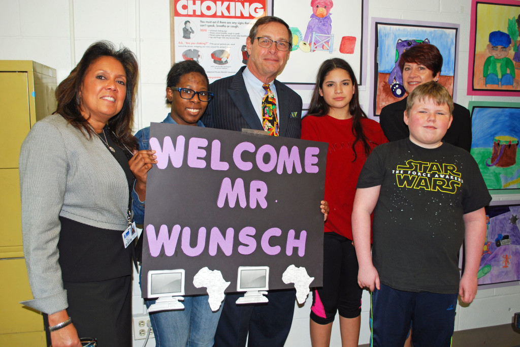 Welcoming Peter Wunsch (third from left), president of the Western Suffolk BOCES Board of Education are (from left) Chandra Rivera, principal, Brennan Middle/Senior High School; Deja Flemmings, senior, Wyandanch School District; Dianne Ramos, eighth grade, South Huntington School District; Teresa Strum, Executive Director, Special Education Division, WS BOCES; and Joseph Polk, eighth grade, Commack School District.