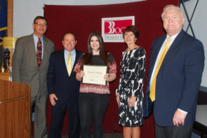 Victoria Valenti of Commack (center) is congratulated by (from left) Board Peter Wunsch, Principal Thomas Logatto, Special Education Executive Director Teresa Strum and COO Michael Flynn.