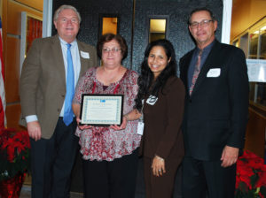 West Babylon Board of Education President Lucy Campasano (second from left) and Superintendent Dr. Yiendhy Farrelly (third from left) accept a Proclamation of Appreciation from Western Suffolk BOCES Chief Operating Officer Michael Flynn (left) and Board of Education President Peter Wunsch for his district's support of the External Diploma Program.