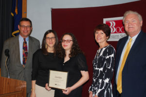 Zoe Klein (center) is congratulated by (from left) Board President Peter Wunsch, Teacher Coordinator Stacey Governa, Executive Director Teresa Strum and COO Michael Flynn.
